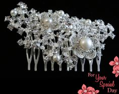 What a beautiful floral hair brooch comb with sparkly rhinestones and pearls! Made of grade A+ crystal rhinestones, fresh water ivory pearls and the most shiny silver plated metal you have ever seen. Sure to be stunning on Your Special Day. by ForYourSpecialDay, $44.99