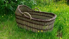 A Moses basket /Baby cot made by Hanna Van Aelst, Barnabaun Basketry in Ireland from home-grown willow.