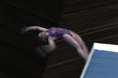 A member of Crystal Palace diving club dives during a training session in London March 9, 2012.  REUTERS/Stefan Wermuth
