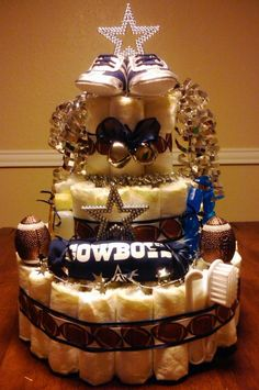 SOMEONE SHOULD MAKE ME THIS!!! :) Dallas Cowboys baby diaper cake