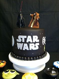 Starwars Cake for chuck...im thinking cut out letters stuck onto buttercream and figures ontop