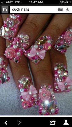 Well, that's one way to keep from picking your nose I guess. It's like she ate Dream Barbie and her house with her nails. Rhinestone Nails, Bling Nails, 3d Nails, Swag Nails, Acrylic Nails, Feet Nails, Pink Bling, Glitter Nails, Crazy Nail Art
