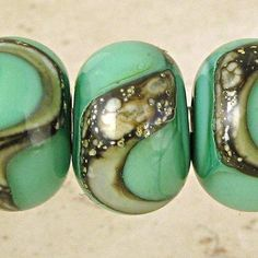 Celadon green lampwork glass beads with some silver. Beautiful!