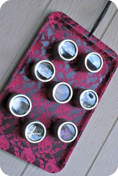 Upcycled cookie sheet, spray painted and covered with lace then turned into a craft organizer