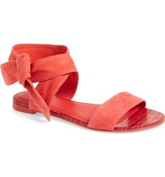 A wide, wraparound ankle strap enhances the vintage sophistication of a minimalist flat sandal.
