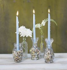 Nestle our miniature candles into vase filler to create lovely accents for your tablescapes! Pair with clear glass bud vases for a visibly unique touch.
