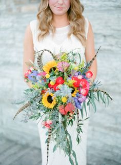 Colorful Feather Bouquet - Warmth and Happiness: 20 Perfect Sunflower Wedding Bouquet Ideas - EverAfterGuide