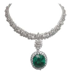 Magnificent Emerald Diamond Necklace.     A very beautiful piece necklace and precious jewelry.The weight of the diamond is 95.14 carats features F color and VVS clarity and the extraordinary emerald piece weight 68.88 carats. Via 1stdibs.
