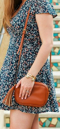 Cute floral wrap dress, cognac tassel handbag, gold lion cuff bracelet, engraved gold bracelet, and long blonde hair styled in a affordable spring outfit idea by Florida beauty and style blogger Ashley Brooke Nicholas #MyHCLook sponsored by @haircuttery     Hair Cuttery, blonde hair styling ideas   cute dresses, affordable summer fashion, spring style, gold heels, Sam Edelman, Old Navy, Baublebar, Abercrombie & Fitch, colorful stairs, preppy fashion, preppy style