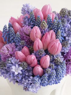 Pink Tulips contrast so sweetly with pale blue Hyacinths and Muscari