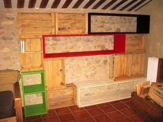 Biblio-tetris, Bookshelf Out of Repurposed Crates & Pallet Planks