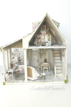 "I called this newest dollhouse ""In Tatters"".  It's another shabby chic style.  This one has a little terrace to sip your morning coffee. ..."