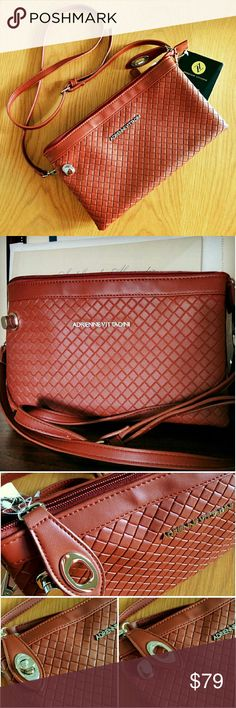 """39✂Adrienne Vittadini Woven Crossbody ClutchHP PRICE IS FIRM (Seeon TITLE) Make me an offer, it's YOURS! ➖➖➖  ✨NWT✨  ⏩Made of high quality woven faux leather, this bag features deep, luxuriously gorgeous brown cognac color. So classic & elegant!  ⏩UNIQUE feature of front TWIST LOCK to secure the zipper pull  ⏩Top zip closure ⏩Interior➖3 open compartments, 2 slip pockets, 1 zip pocket  ⏩Adjustable, DETACHABLE strap lets you convert the clutch into crossbody  Size(apx) 11"""" x 7"""" 22"""" max strap…"""