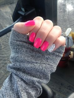 Neon pink nails with accent nail.
