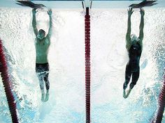 ABD'li yüzücü Michael Phelps'in, 2008 Pekin Olimpiyatları'nda 100 metre kelebek finalinde Sırp yüzücü Milorad Cavic'i saniyenin binde biri farkla geride bırakarak altın madalyaya uzandığı an... Bu Phelps'in Pekin Olimpiyatları'nda kazandığı 8 altın madalyanın yedincisiydi.