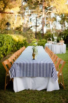 Long table and navy striped linen. Photography by theyoungrens.com, Event Design by extraordinaryevents.net, Floral Design by cvflowermart.com  https://www.amazon.com/Whole-Lotta-Bull-McGreers-ebook/dp/B00PHDRHZG