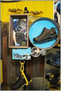 Clever and cool ways to display shoes, courtesy of Keen. Circles aren't what you'd expect, but they frame a hiking shoe nicely. I especially like the giant carabiner, with a shoe holder inside, dangling from the bottom of the display.