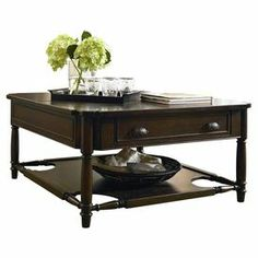 """Lift-top coffee table with 1 drawer and a lower display shelf. Product: Coffee tableConstruction Material: Poplar veneers and hardwood solidColor: Distressed molassesFeatures:Part of the Paula Deen Home CollectionLift-topLower display shelfOne drawerWill enhance any decor Dimensions: 21"""" H x 42"""" W x 42"""" D"""