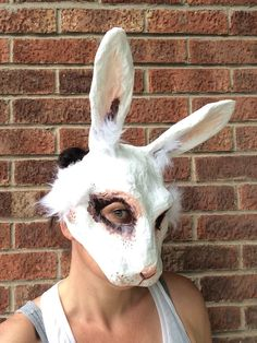 A personal favourite from my Etsy shop https://www.etsy.com/uk/listing/468036379/white-rabbit-mask-paper-mache-animal