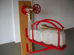 Antique 1884 fire hose rack with brass valve & nozzle