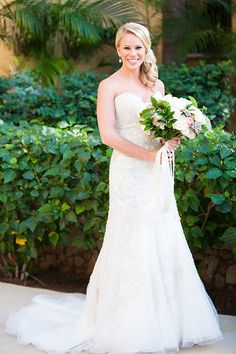 Kyle Rudolph's Destination Wedding in Los Cabos, Bride in Strapless Allure Bridals Wedding Dress | Brides.com