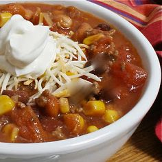 I love easy!    Ingredients:  1 can of each:  Chicken broth  Chicken n' Rice soup  Ranch style beans  Corn, undrained  Rotel  Chicken breast, chunks