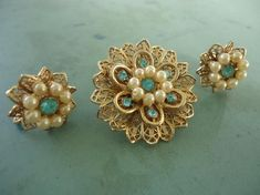Very nice set of matching flower like brooch with matchingscew back earringsgoldtone setting with faux pearls and aquamarine colored stonesgood quality! brooch is: 1 diameter Real Diamond Earrings, Skull Earrings, Vintage Earrings, Etsy Earrings, Nose Jewelry, Jewellery, Aquamarine Colour, Gold Earrings Designs, Smoky Quartz