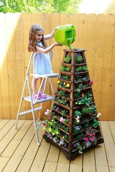 Earth Tower Vertical Garden: Wooden Planter on Wheels When space is tight consider the Earth Tower Vertical Garden. Training future Urban Gardeners with Earth Tower DIY Flower Towers Ideas: Classic Flower Tower to Maximize Space Unusual Flower Towers Idea Vertical Succulent Gardens, Vertical Garden Diy, Vertical Planter, Garden Ideas To Make, Flower Tower, Tower Garden, Wooden Planters, Wooden Garden, Raised Garden Beds