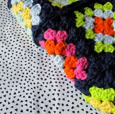 Stashbusting Blanket ~ I however would love to make a scarf with this pretty navy blue as the background!