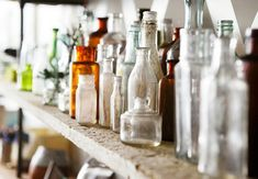Vintage Glass Bottles - What I think is funny, I have been using glass bottles for decor for years... now it is chic....