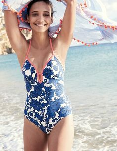 Take the plunge in this flattering V-neck swimsuit. A few clever little hidden features will keep you feeling confident – like the body-sculpting support lining and lightly padded fixed cups. Its tie halterneck can be adjusted to create a customised fit that's perfect every time.