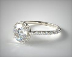 This 14k white gold pave halo and shank diamond engagement ring (round center) is available exclusively from JamesAllen.com