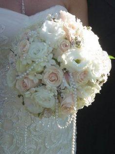 vintage ivory wedding bouquet with pearls / http://www.deerpearlflowers.com/vintage-pearl-wedding-ideas/
