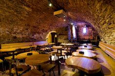 Usudu Prague - underground bunker bar a few blocks from the Dancing House. A little hard to find, and you have to go down three flights of stairs to get there (pass the fooseball tables). Definitely worth it!