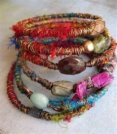 Sari silk yarn wrapped bracelets. Just a photo. Thought: heavy wire for stringing the beads, followed by silk wrap, followed with lighter wire wrap?