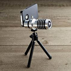 iPhone Zoom Lens & Tripod  Lightweight, easy-to-use lenses and tripod from Restoration Hardware. Polarized macro and fisheye lenses lend extreme zoom and wide-angle capability, and the foldable tripod is maximally effective when stability is necessary.