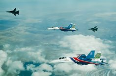 Su-27s of the Russian Knights aerobatic team being escorted by Iranian F-14 Tomcats Fighter Aircraft, Fighter Jets, Uss Zumwalt, Tomcat F14, Cruise Missile, Aviation News, Russian Air Force, Sukhoi, Battle Tank