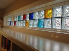 Eye popping Piet Mondrian inspired colored glass block transom highlights a new studio office space Bathroom Window Glass, Brick Bathroom, Frosted Glass Window, Window In Shower, Bathroom Windows, Glass Block Basement Windows, Glass Blocks Wall, Window Blocks, Block Wall