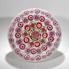 "Parabelle Glass 1998 concentric millefiori paperweight, including red and pink roses, pink pansies, hearts and other complex canes around a large central red, pink and green aventurine rose, on cross-hatched white latticinio; signed and dated. Artist proof.Diameter 3 1/8""  http://www.lhselmanltd.com/"