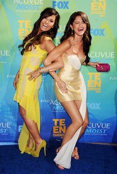 Demi Lovato and Selena Gomez. Having fun posing for a camera