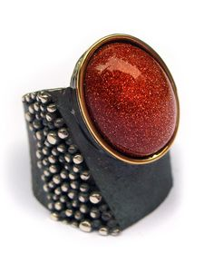 Elisenda de Haro. Contemporary jewelery.  Art Deco ring white or oxidized silver, gold and gold aventurine