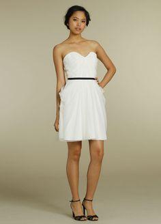 Ivory pointe d esprit strapless A-line bridesmaid dress, curved neckline, pleated bodice, black ribbon belt at natural waist.