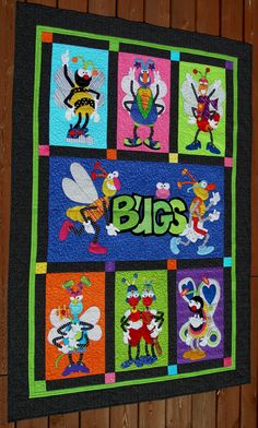"Applique ""Bugs"" quilt I Like the different coloured background and border"