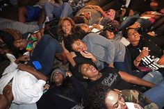 """Hundreds of demonstrators, many of them Howard University students, lie on the ground in protest outside the White House after the Ferguson grand jury decision was announced."""