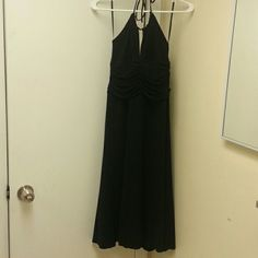 BCBG black dress Brand new with tags knee length halter dress, BCBG Maxaria. Retail $219 I got on sale for $109 BCBGMaxAzria Dresses Midi