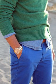 Shop this look for $61: http://lookastic.com/men/looks/green-crew-neck-sweater-and-light-blue-chambray-longsleeve-shirt-and-blue-chinos/1685 — Green Crew-neck Sweater — Light Blue Chambray Longsleeve Shirt — Blue Chinos
