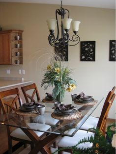 Eat In Kitchen With Glass Table And Chandelier