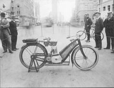 One of the first N.Y.P.D. motorcycles, early 1900's period. The Flatiron Building can be seen in the Background.