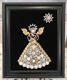 This gorgeous, handmade Angel is designed from mainly rhinestone vintage and costume jewelry mounted on black velvet inside a beautiful new black frame. The frame can be either hung on the wall or displayed in an easel, This original one-of-a-kind piece of art is a perfect