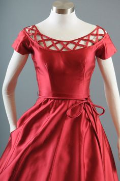 This crisp red silk dress features delightful lattice work at the neckline.  #1950s #dress #red
